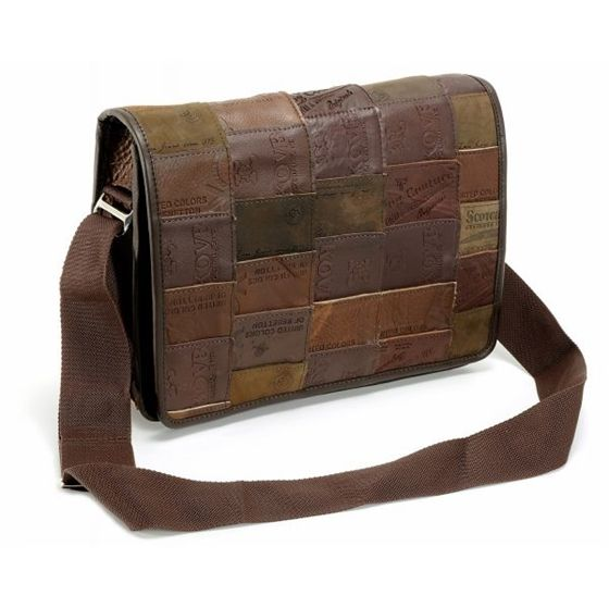 This messenger bag is made from re-purposed jeans labels. The inside is lined with denim canvas, and there is one compartment with a zippered pock ...