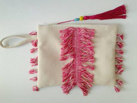 Check out this item in my Etsy shop https://www.etsy.com/listing/520341749/boho-chic-wristlet-clutch-with-fringes