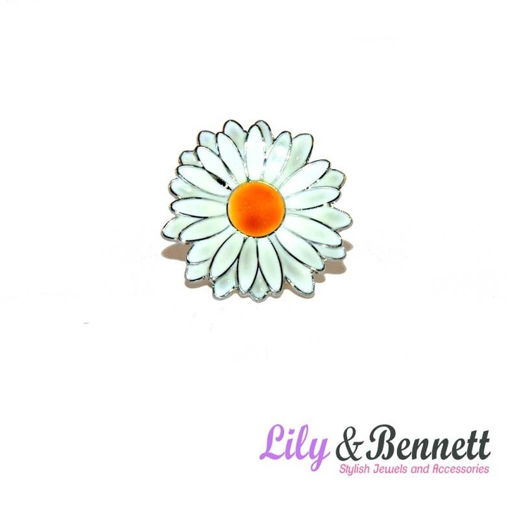 This pretty daisy ring will put you in a good mood from morning until evening.  www.lily-bennett.com