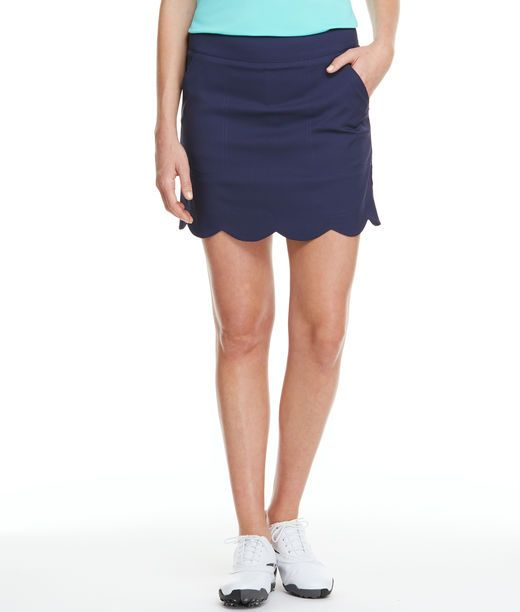 Improve your game from course to clubhouse in this adorable women's golf skort with its scalloped hem. With the built-in stretch and shorts, this just might become your favorite golf attire, too.