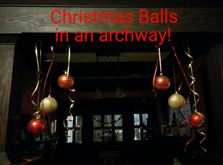 Use thumb tacks to hang pretty balls in an archway! Super fast and easy Christmas home decor!