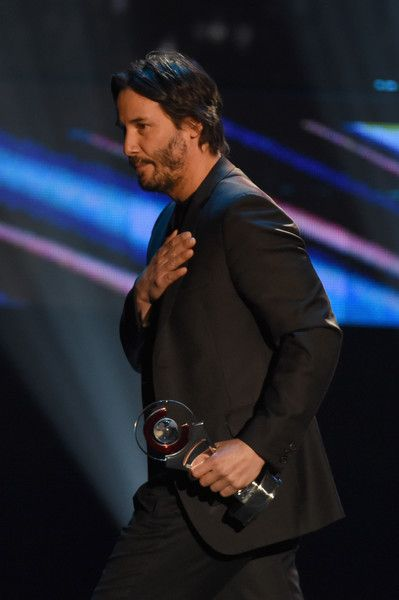 2016 April 14th.   Keanu Reeves accepts Vanguard Award during CinemaCon Big Screen Achievement Awards by the Coca-Cola Company at The Colosseum at Caesars Palace during CinemaCon, the official convention of the National Association of Theatre Owners in Las Vegas, Nevada.