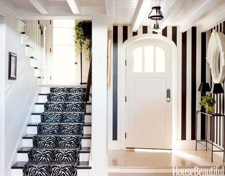 Black and white stripes in the foyer. Design: Carleton Varney. housebeautiful.com. #black_and_white #stripes #foyer #entry