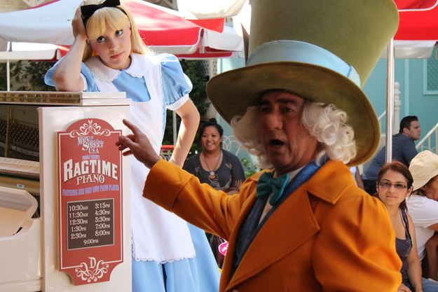 Once a day the Mad Hatter and Alice play musical chairs with kids at Coke Corner on Main Street. | 35 Insider Hacks For Taking Your Kids To Disneyland