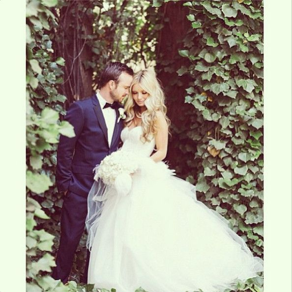 Aaron and Lauren Paul married long-time girlfriend Lauren Parsekian on May 26, 2013. The Breaking Bad star's leading lady wore an Amsale tulle gown with a sweetheart-cut bustier.