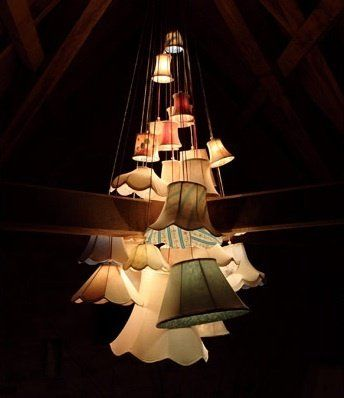 I love this chandelier made from a cluster of mismatched lampshades! Could be a unique DIY.