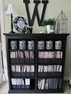Vinyl Covered Recycled Cans - ask your local pizza place for the large cans tomatoes, etc come in, then cover with vinyl for spruced-up storage