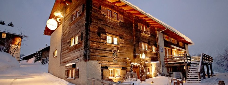 Guarda val hotel in lenzerheide - cool old timbers on facade over windows - combo of Swiss barn style with modern glass - also cool bar with Cassina bar stools