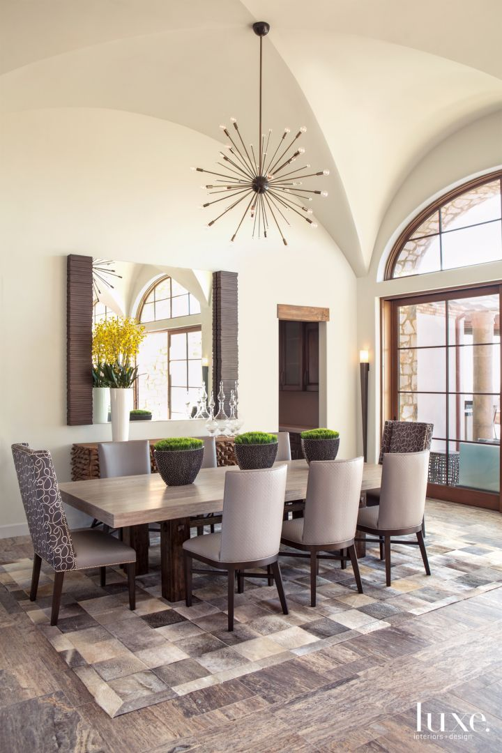 Custom Chairs Surround A Reclaimed Wood And Metal Table By Artifacts  International In The Dining Area. Crowning The Ensemble Is A Starburst  Pendant By ...