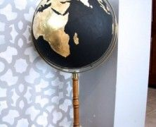DIY Black and Gold Globe. Unfortunately - no instructions, but should be easy enough with gold leaf and black paint.