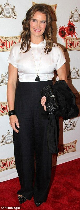 Classy Brooke: Ms. Shields looked stunning in wide-legged trousers and white blouse as she...