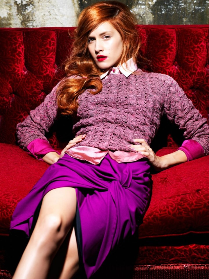 Skirt, sweater and shirt in pink and purple tones.