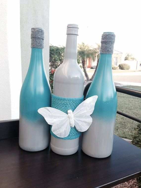 Set of upcycled wine bottles for your home decor or as a gift! Spray painted Wine Bottles with added yarn and embellishment of white