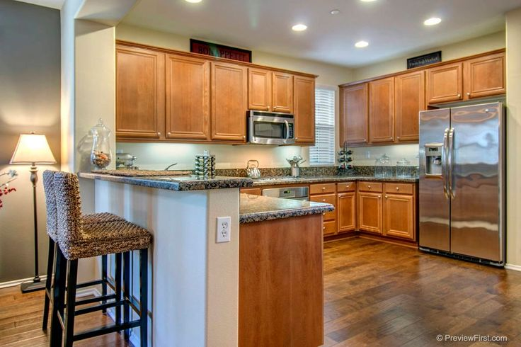 Traditional Kitchen with Flat panel cabinets, Pier 1 kubu barstool, CFL Sutter Adjustable Lever Floor Lamp Base, Raised panel