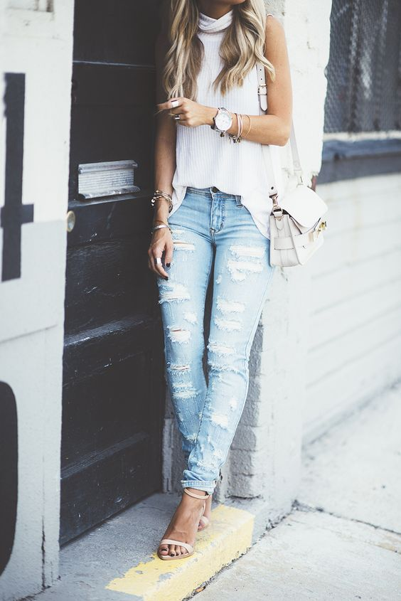 white tank top light wash ripped blue jeans heels