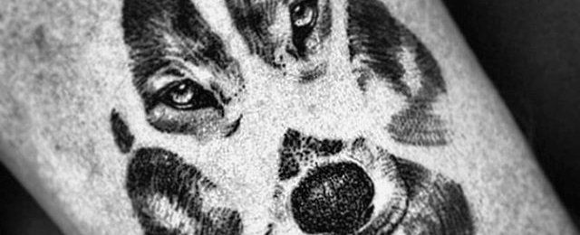 Discover a sharpened set of tracks left behind with the top 50 best wolf paw tattoo designs for men. Explore cool animal print ink ideas and body art.
