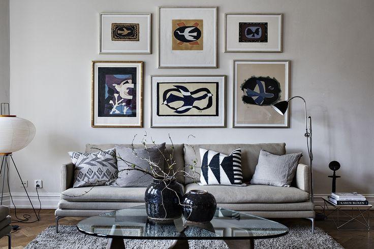 gray couch, modernist art, noguchi coffee table, scandinavian design