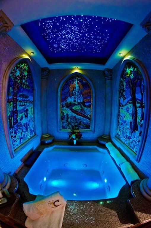custom-made 4 x 4, multi-jet Jacuzzi with waterfall faucet and chromatherapy lighting.
