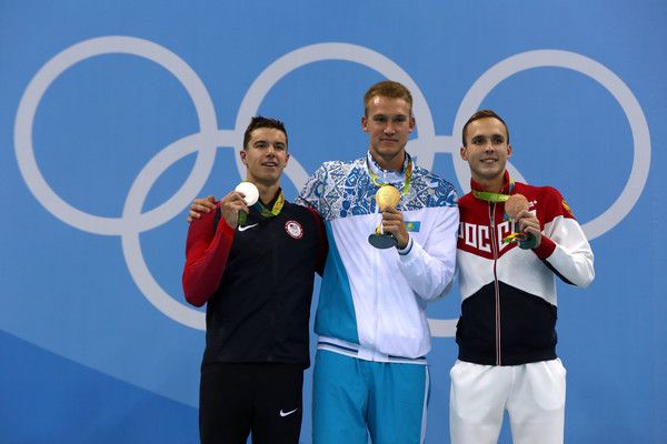 Silver medalist Josh Prenot of the United States, gold medalist Dmitriy Balandin of Kazakhstan and bronze medalist Anton Chupkov of Russia pose on the podium during the medal ceremony for the Men's 200m Breaststroke Final on Day 5 of the Rio 2016 Olympic Games at the Olympic Aquatics Stadium on August 10, 2016 in Rio de Janeiro, Brazil