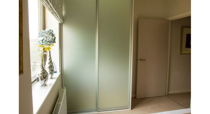 Floor to ceiling frosted mirror wardrobe. Below is a link to our online calculator to see how much your bespoke made to measure wardrobe will cost http://www.foxwardrobes.co.uk/instant-online-estimator/