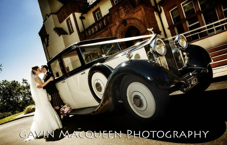 The Bride and The Groom with their vintage wedding car at The Carnbooth House Hotel, Glasgow.