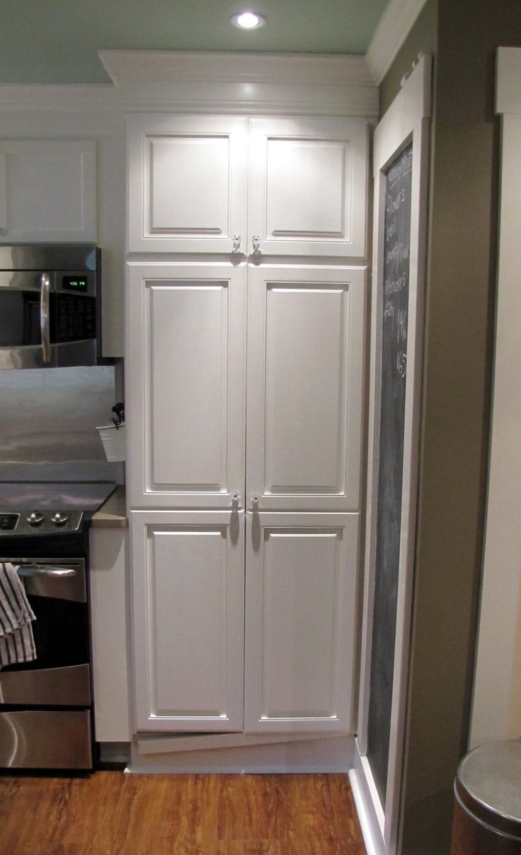 armoire pantry - add crown moulding to give it a built in effect