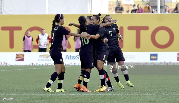 July 14 - Football - Women - First Round. Mexico vs Argentina.  Jennifer Ruiz (2nd-R) of Mexico celebrates with teammates the third goal against Argentina during their women's group A first round football match for the Pan American Games in Hamilton, Canada, on July 14, 2015. AFP PHOTO / OMAR TORRES