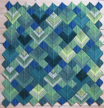 Jeg synes, at dette tæppe er VILDT FLOT. Hvis du også synes det, kan du se mere om tæppet her hos Markno. Det er ovenikøbet sjovt at strik...