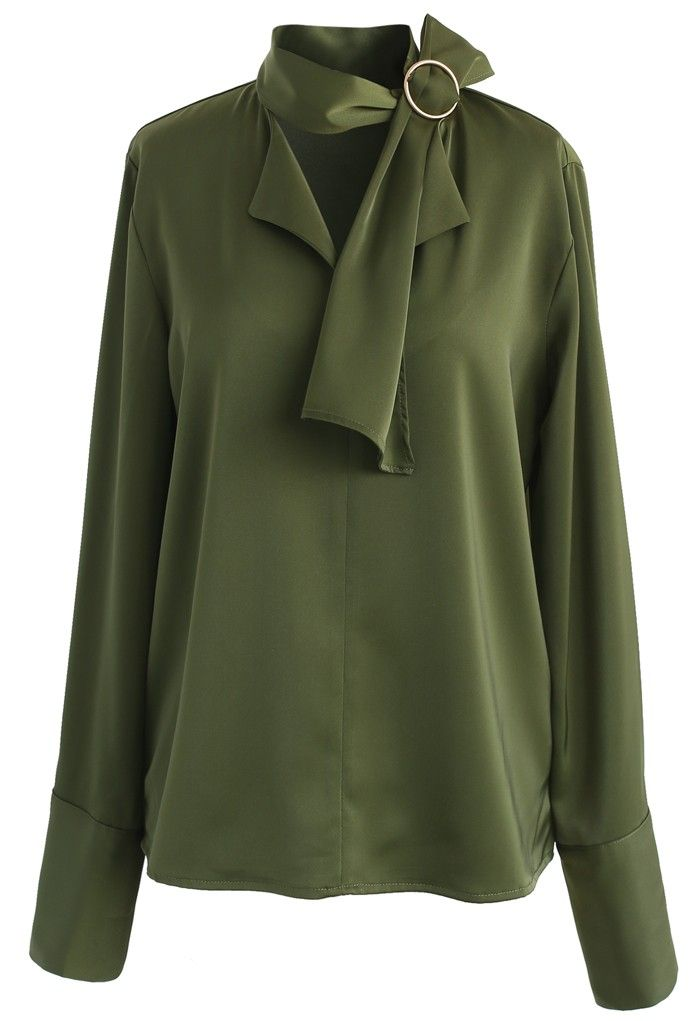 If you've got a weakness for all things classy, then the loose silhouette of this smock top with its neutral green hue is the perfect blouse to give in to this season. The self-tie sash with its O-ring on neckline provides an added dose of softness. - Self-tie sash with O-ring on neckline - Buttoned cuffs - No lining - 100% Polyester - Hand wash Size(cm) Length Bust Shoulder Sleeves S/M 61 98 40 63 Size(inch) Length Bust Shoulder Sleeves S&...