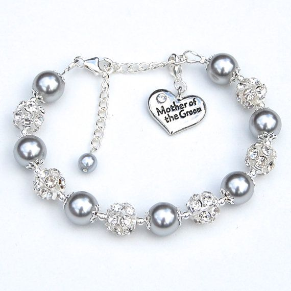 Silver pearls and sparkling rhinestones combined with a silver heart inscribed with the word Mother of the Groom make this an elegant keepsake
