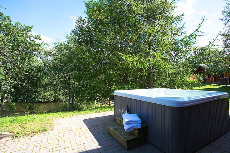 Private hot tub at Gingerbread Cabin sleeps 6