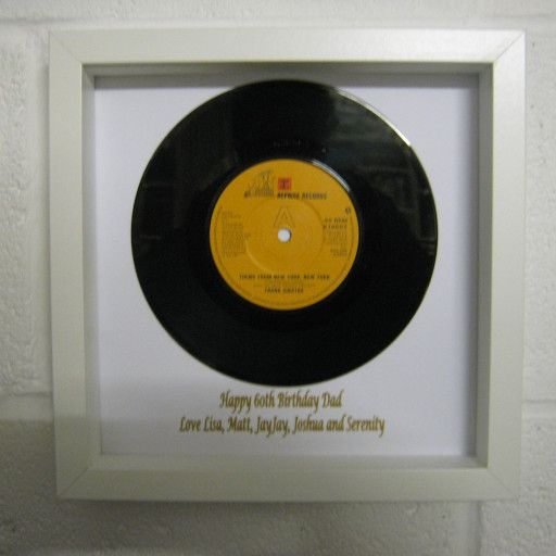 """Up-cycled 7"""" vinyl record, stylishly framed in a new wooden shadow box for maximum enjoyment.  For the greatest choice of musical gifts head over to our dedicated website at; Musicthroughtimegifts.com  For a clear picture the window has been removed to show the overall effect. If you would like a personal message added we are happy to oblige at no extra cost.  Picture frame measures 23cm x 23cm and is 4.5cm deep.  Easy to place on your wall with a purpose built hanger already on the back..."""