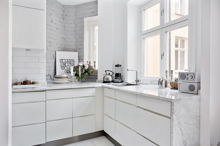 modern white kitchen and white painted brick wall photo from http://www.perjansson.se/