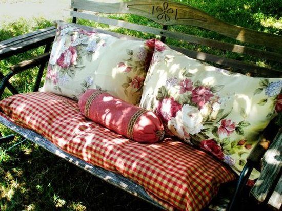 what a lovely country bench to just sit on and enjoy your lovely garden...