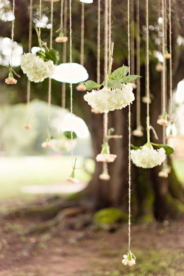 flowers hanging on twine // photo by Glass Jar Photography // http://ruffledblog.com/georgia-oak-tree-elopement