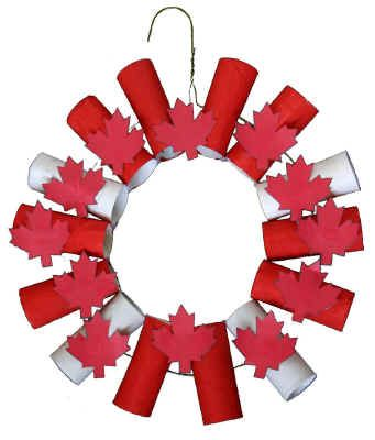 Toilet Paper Wreath-Canada Day Needed: coat hanger, 12-15 toilet paper rolls, red paint, glue, tape & scissors