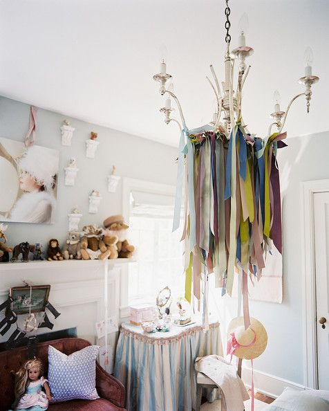 Eclectic Decor - A chandelier decorated with ribbon in a children's bedroom