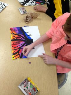This is blog with ideas for art class activities for kids, but I totally want to try this stained glass effect on my own now!