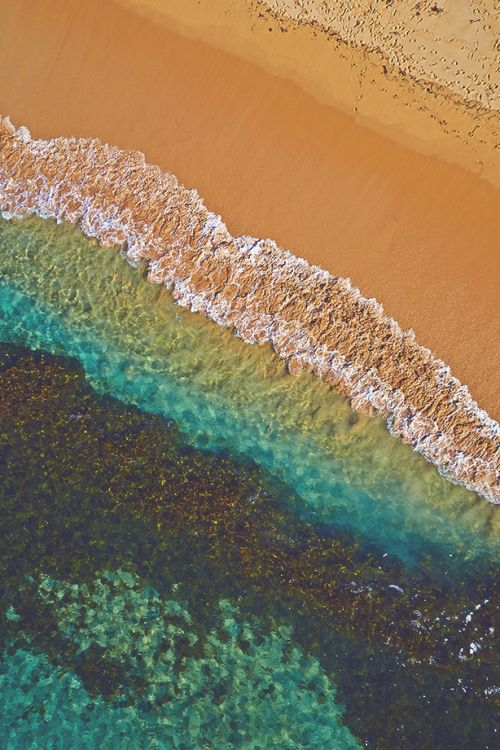 Water and sand mix to create ocean rainbow, Manly Beach, Sydney, Australia. By Remy Gerega.