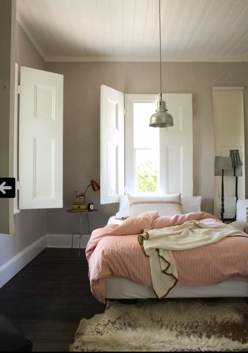love this room. color, texture, light. the window shutters are awesome, too.