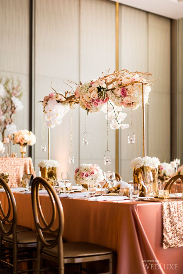 Suspended pink and gold installation. Design, florals, and linens: Platinum Events Group. Fuchsia Designs. The Linen Closet.