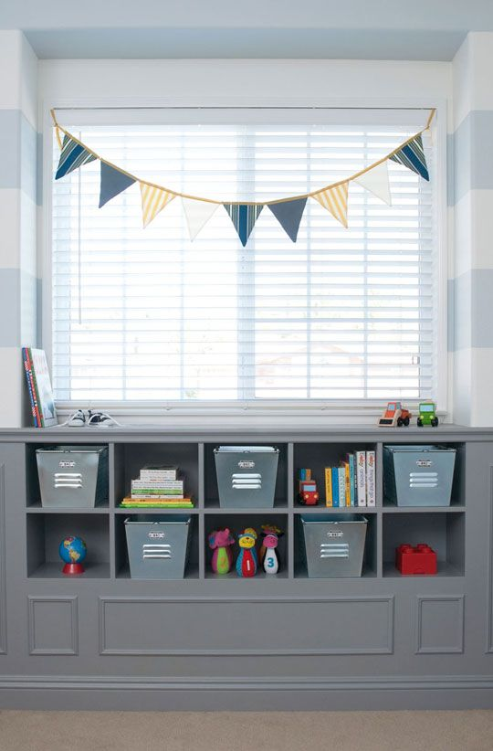 love this idea for nursery...bookshelves under large window with pennant banner hanging above