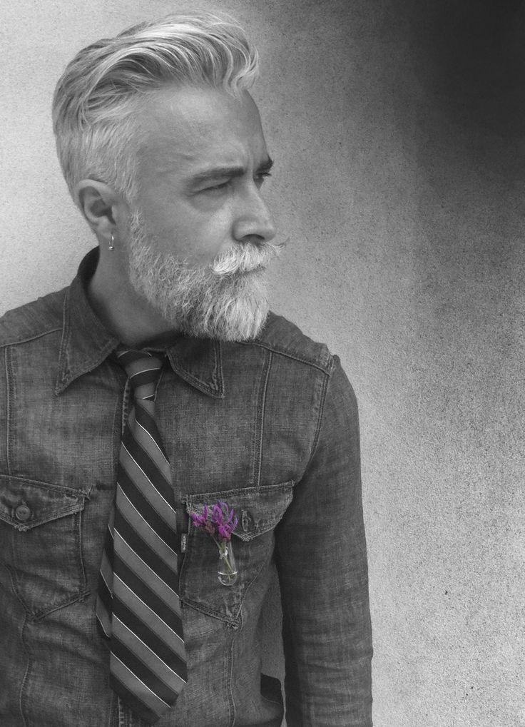 Alessandro Manfredini, handsome gray haired man.