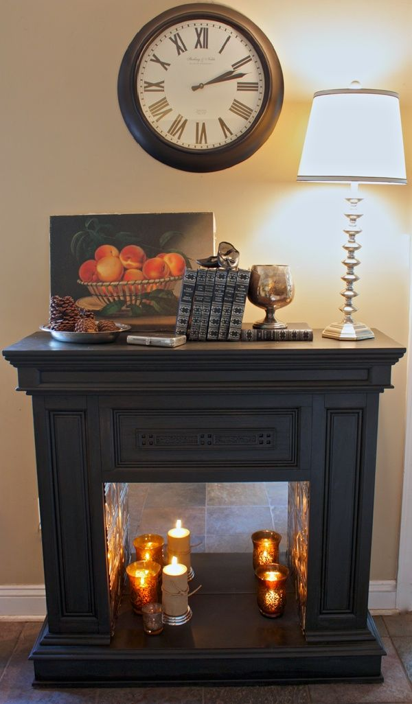 Fireplace Makeover With Mirrored Back And Pressed Tin