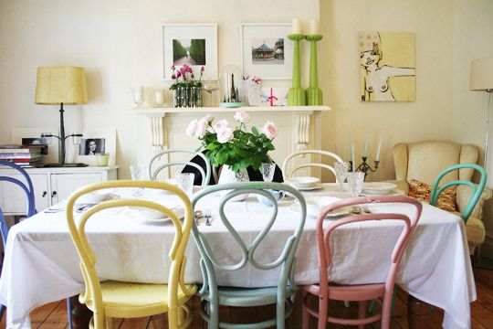 love the mismatched, colorful chairs. Going to do this for a mad hatter theme in dining room