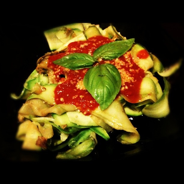 Pappardelle of zucchini with tomatoes sauce and Parmigiano Reggiano.