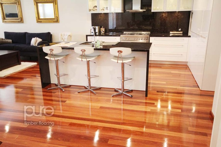 Jarrah Floorboards- we also have white cupboards and black benchtops in our home