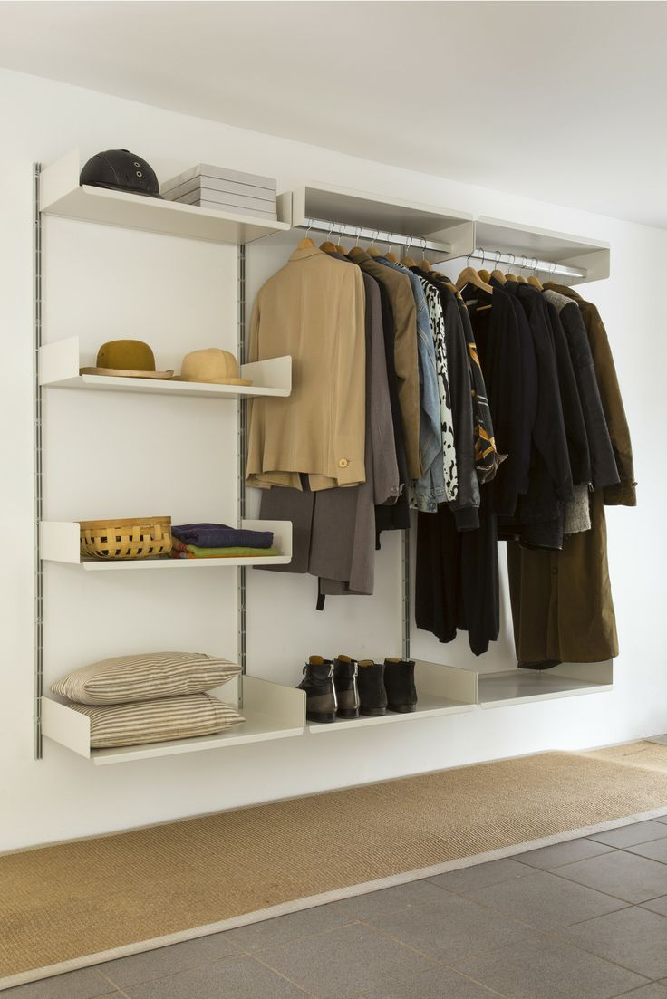 Open storage displays your character. This three-bay wall mounted system  makes room for full-length winter coats but can be rearranged to suit any  season