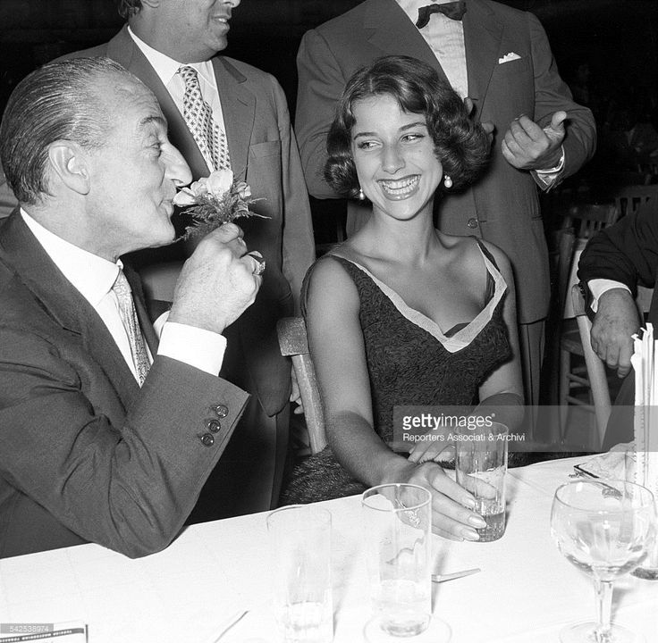 Italian actor Tot˜ (Antonio De Curtis) and his wife Italian actress Franca Faldini, sitting at a dinner table during a party. Rome, 1955