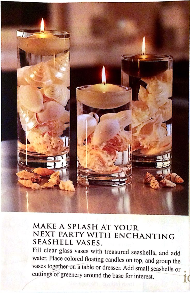 Floating candles with seashells centerpiece